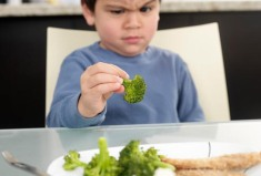 corbis_rf_photo_of_boy_frowning_at_brocolli